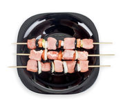 Raw meat on sticks on a plate Royalty Free Stock Images