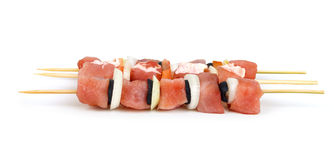 Raw meat on sticks in a row Stock Photo