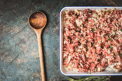 Raw Meat stuffing with rice and minced meat with cooking spoon Royalty Free Stock Images