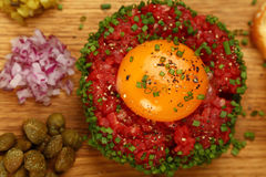 Raw meat tartare steak with egg yolk close up Stock Photos