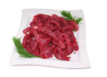 Raw Meat. Uncooked fresh beef slices isolated on white Stock Photography