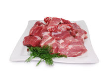 Raw Meat. Uncooked fresh pork slices isolated on white Stock Photos