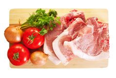 Raw meat and vegetables. Isolated over white Royalty Free Stock Photography