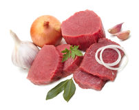 Raw meat with vegetables. Isolated Royalty Free Stock Images