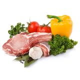 Raw meat with vegetables. Isolated on white background Stock Photography