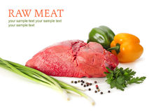 Raw meat with vegetables. On white Royalty Free Stock Images