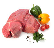 Raw meat with vegetables. On white Stock Images