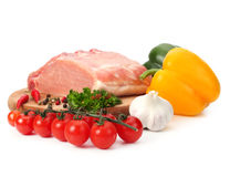 Raw meat with vegetables. On white Royalty Free Stock Photography