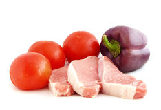Raw meat with vegetables. Isolated on white Stock Photo