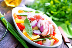 Raw meat with vegetables. In the bowl Royalty Free Stock Images