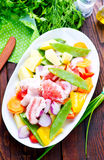 Raw meat with vegetables. In the bowl Royalty Free Stock Photo