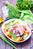 Raw meat with vegetables. In the bowl Stock Images