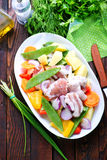 Raw meat with vegetables. In the bowl Stock Photography