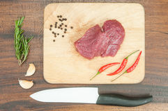 Raw meat, vegetables and chef knife. Fresh  raw meat, vegetables and chef knife Royalty Free Stock Photos
