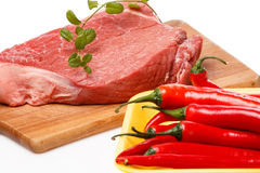 Raw meat and vegetables. On chopping board Stock Images