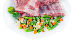 Raw meat and vegetables. fragment Stock Image