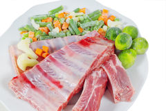 Raw meat and vegetables Royalty Free Stock Photos