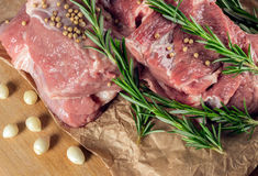 Raw meat with vegetables and greens on a wooden table surface. Preparation of dinner Stock Image