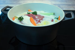 Raw meat and vegetables pickled in buttermilk. In pot Stock Photography
