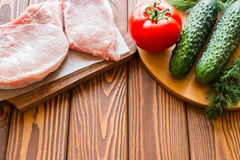 Raw meat and vegetables. With space for text Stock Photo