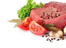 Raw meat, vegetables and spices. Over the white Stock Photography