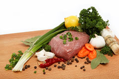 Raw meat, vegetables and spices. Raw meat, vegetables and spices isolated on a wooden table Stock Photography