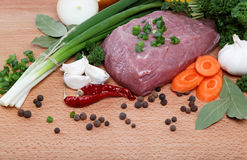 Raw meat, vegetables and spices . Raw meat, vegetables and spices  on a wooden table Royalty Free Stock Photos