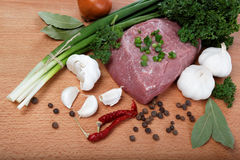Raw meat, vegetables and spices. Raw meat, vegetables and spices  on a wooden table Royalty Free Stock Photo