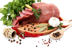 Raw meat, vegetables and spices. Royalty Free Stock Image