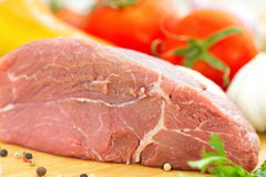 Raw meat with vegetables and spices Royalty Free Stock Photos