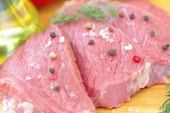 Raw meat with vegetables and spices. Sliced raw meat with vegetables and spices Stock Photo
