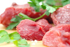 Raw meat with vegetables and spices. On the table Stock Images