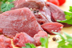 Raw meat with vegetables and spices. On the table Royalty Free Stock Photography