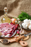 Raw meat, vegetables and spices. Uncooked meat : raw fresh beef pork  ready to cooking with garlic, onions, parsley, dill,mushrooms,quail eggs,seasonings, salt Stock Photos
