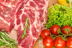 Raw meat with vegetables and spices Stock Photography
