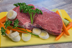 Raw meat with vegetables. On the table Stock Photo