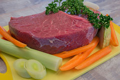 Raw meat with vegetables. On the table Royalty Free Stock Photography