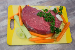 Raw meat with vegetables. On the table Stock Image