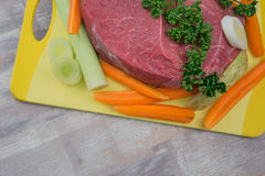 Raw meat with vegetables. On the table Stock Photography