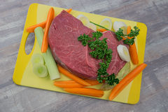 Raw meat with vegetables. On the table Royalty Free Stock Photo
