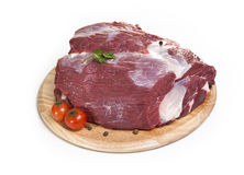 Raw meat on a white background. On a cutting board Stock Photography