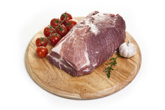 Raw meat on a white background. On a cutting board Stock Images