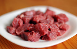 Raw meat. On a white plate Royalty Free Stock Photos