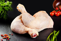 Raw meat. White thighs uncooked poultry chicken with tomato Stock Image