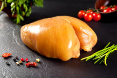 Raw meat. Whole breast chicken for cooking. Birds fed corn yellow chicken Royalty Free Stock Images