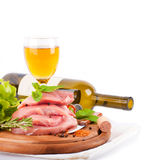 Raw meat, wine and spices on a board Stock Photography