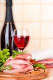 Raw meat, wine and spices on a wood Royalty Free Stock Images