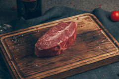 Raw meat. On wood background. Russia, Yekaterinburg royalty free stock photos