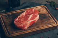Raw meat. On wood background. Russia, Yekaterinburg royalty free stock image
