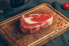 Raw meat. On wood background. Russia, Yekaterinburg royalty free stock photography
